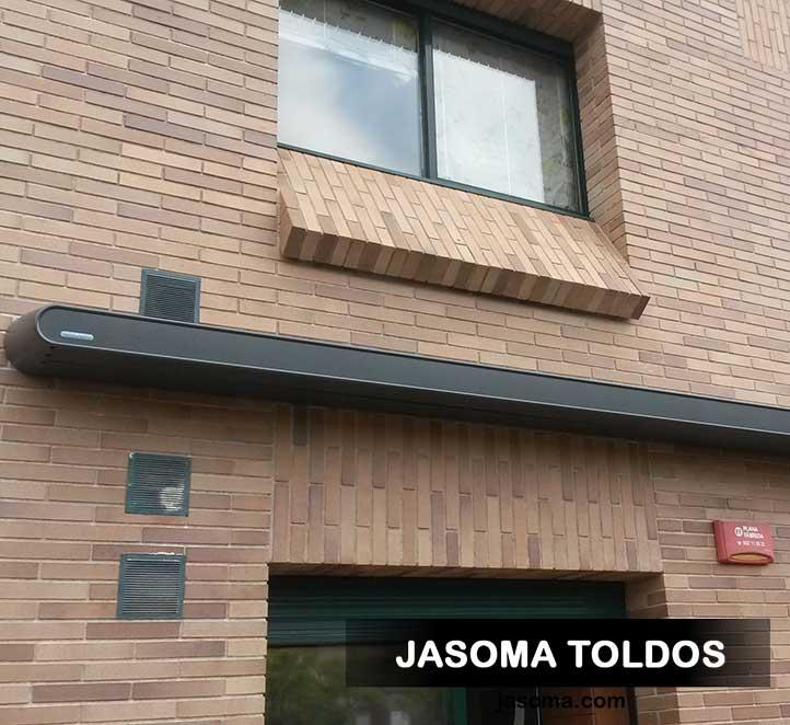 adosado a fachada toldo cofre mx1